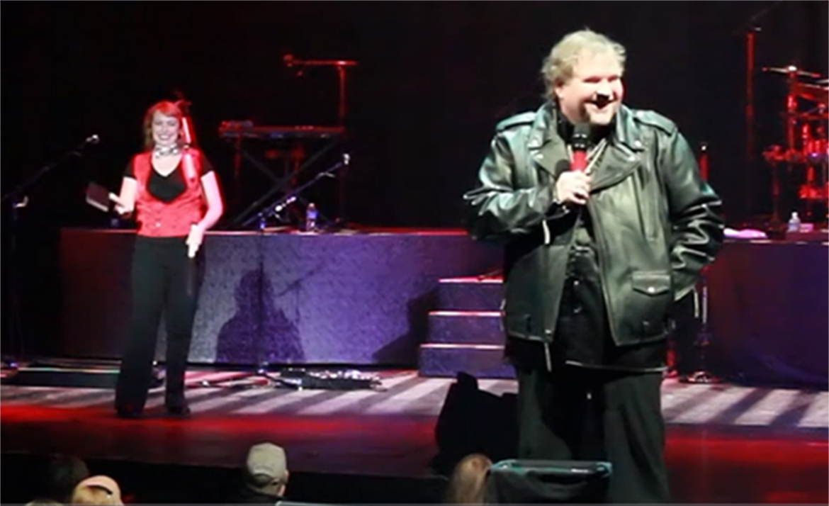 Jennifer juggling meat cleavers on stage at Meat Loaf